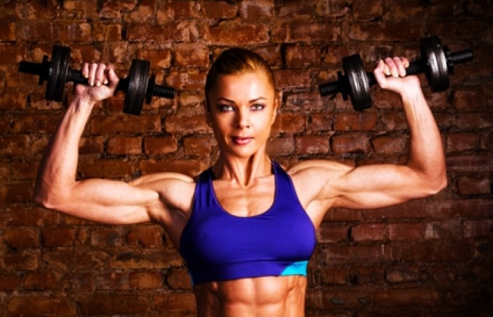 female bodybuilder dumbell pressing