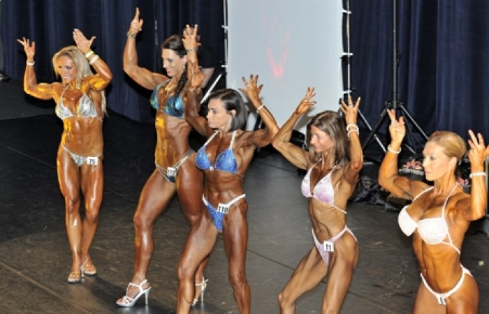 fitness competitors posing for muscle mags