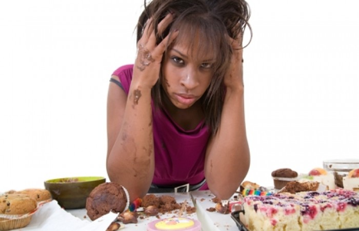 woman overeating carbs