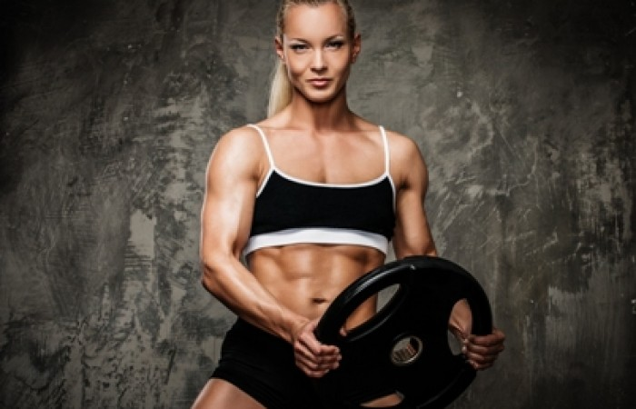 strong woman holding weight plate