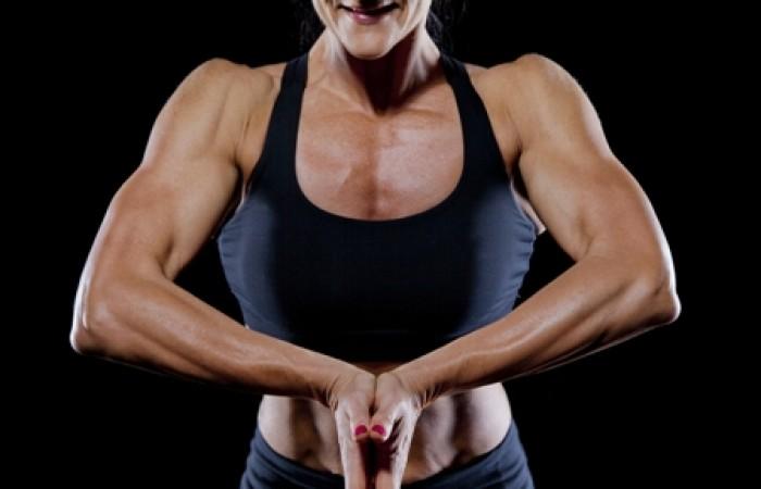 fit woman flexing upper body