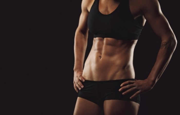 muscle woman with ripped abs