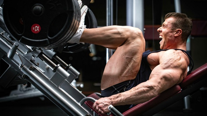 Man leg pressing to help you determine how you should train your legs.