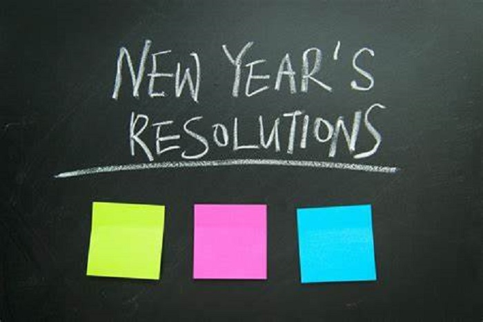 new year's resolution sign on chalk board