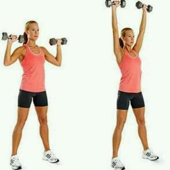 athlete doing shoulder press with dumbbells